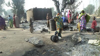 Female suicide bombers kill 56 in Nigerian refugee camp