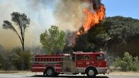 Firefighters battle raging wildfires in California