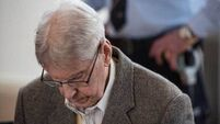 Auschwitz survivor makes emotional plea to former SS guard at trial